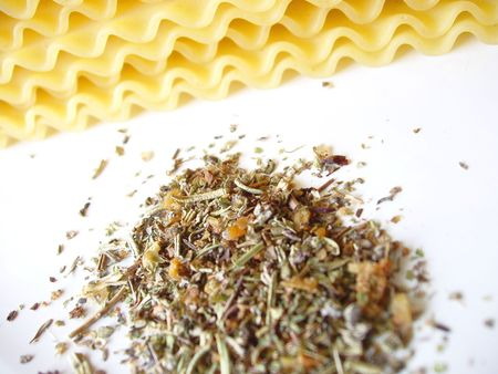 italian spices with uncooked lasagna noodles in the background Stock Photo - 532344