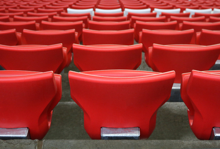 photo red plastic chairs at the stadium