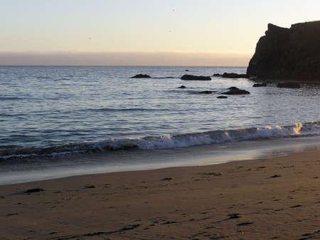 calm ocean waves on the beach        Stock Photo