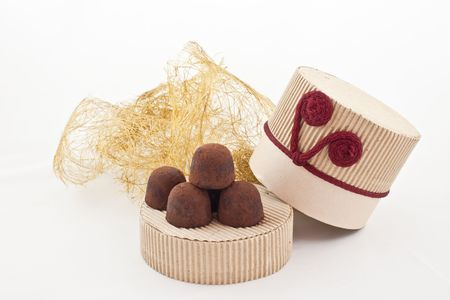 handmade truffles on a cover of gift carton. white background