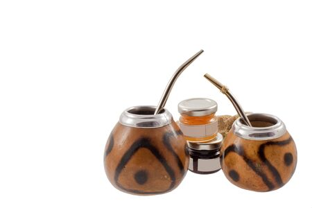 couple of mate cups with two small jam tin. in a right side. isolated photo