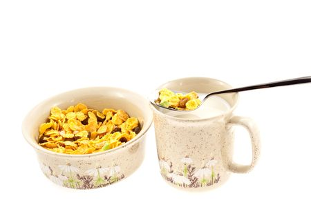 cornflakes with milk in a cup on a white background photo