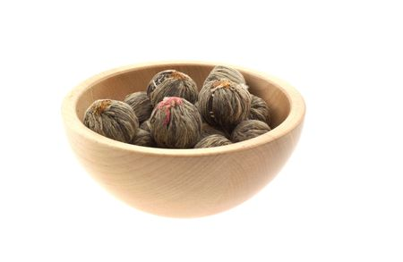 lychee tea in a wood bowl. white background photo