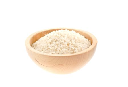 rice seeds in a wood bowl. white background
