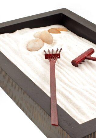 mini zen garden with white sand, stones and wood rakes Stock Photo - 5468440