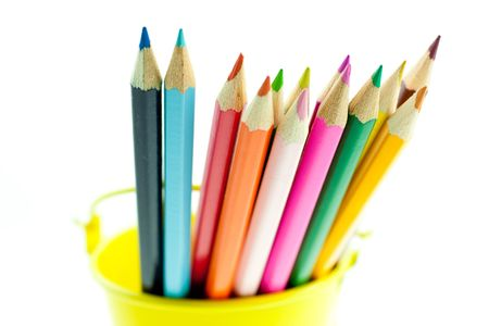crayons in yellow bucket. White background. small GRIP photo