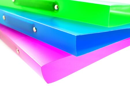 three multicolored folders on white background. small GRIP
