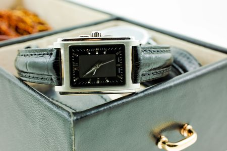 black with silver female watch in a jewelery case. white background photo