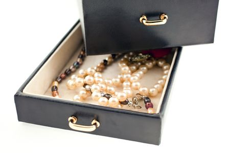 pearl necklaces in a black jewelry box. white background photo