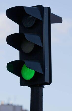 Green light on black traffic signal. small GRIP Stock Photo - 6980403
