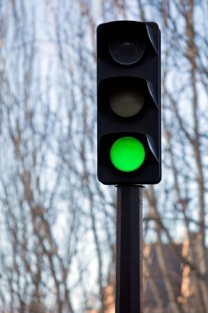 Green light on black traffic signal. small GRIP Stock Photo
