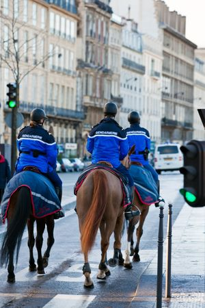 french mounted gendarmerie on a street of Paris. Three persons Stock Photo