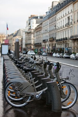 rent bicycle parking on a Paris street. vertical shot
