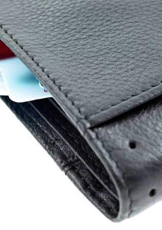 plastic cards in a black leather wallet isolated. vertical shot photo