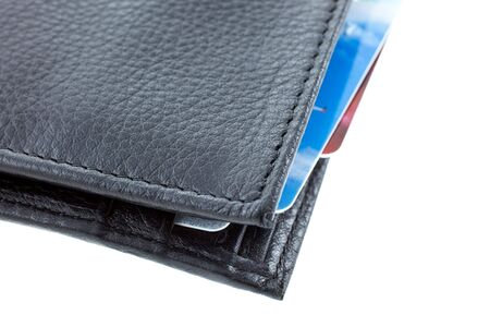 plastic cards in a black leather wallet isolated. horizontal shot photo