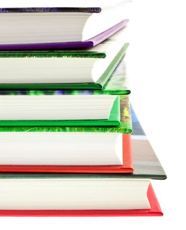 multicolored books stack isolated on white background. vertical shot