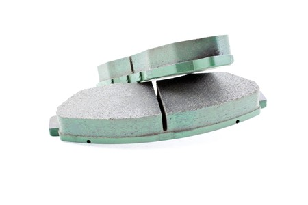 surrogate: front car brake pads on a white background. horizontal shot