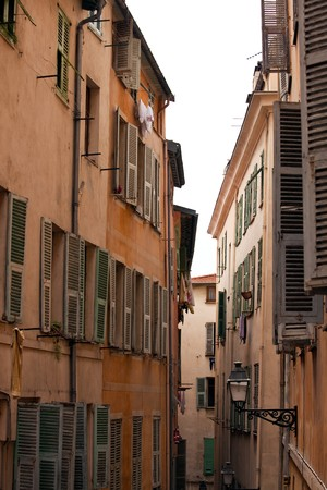 Old street of french town Nice. vertical shot