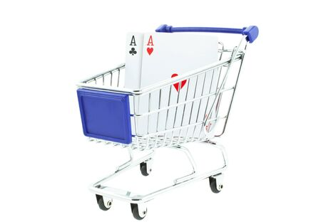 two poker aces in shopping trolley on white background photo