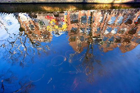 House reflection and old bikes in the canal of Delft. horizontal shot Stock Photo - 8302872