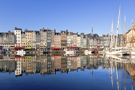 normandy: Honfleur harbour in Normandy, France. Color houses and their reflection in water