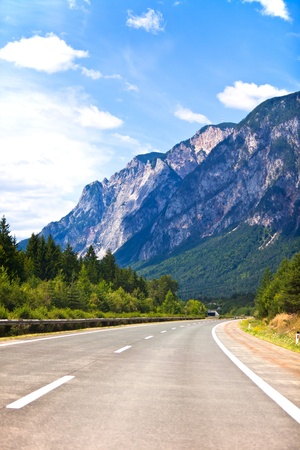 highway in Austrian Alps. vertical shot. another similar shots available