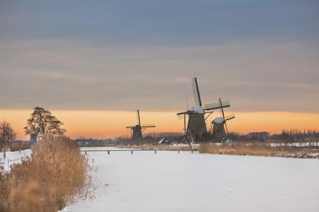 windmills in Kinderdijk, Netherlands at winter sunset. another Kinderdijk shots available photo