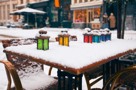 color lamps on street cafe table at snow winter. small GRIP photo