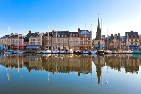 normandy: Honfleur harbour in Normandy, France. Old houses and their reflection in water. another Honfleur shots available Stock Photo