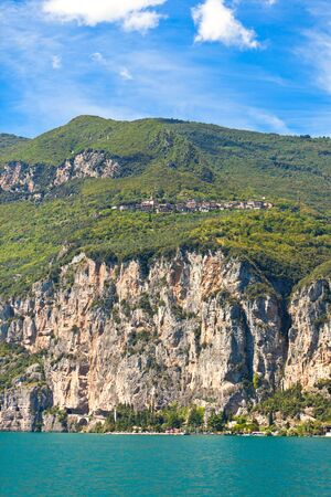 Garda lake landscape. Small town on rocks and another one near water Stock Photo - 9258489