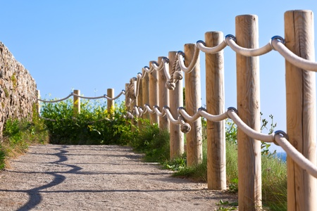 Pathway with wood post and thick rope fence. Taken at Saint-Mathieu, Brittany, France Stock Photo