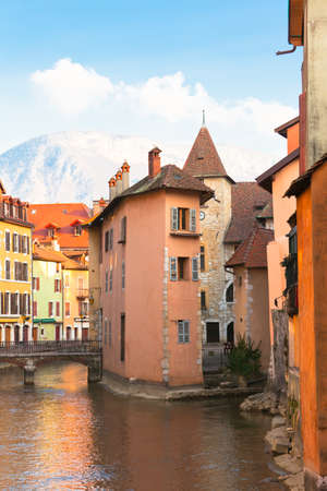Alpes: view over a canal in the medieval town of Annecy, France with French Alpes in background Stock Photo