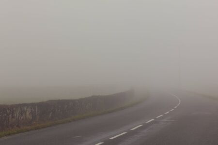 A country road on a foggy day at France.� Stock Photo - 10526705