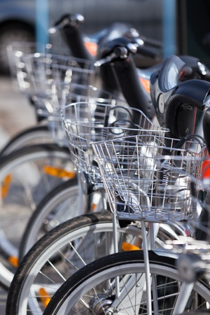 City Hire Bicycles Parked In Row. Small GRIP, the focus is at the center of the image. Stock Photo - 10772107