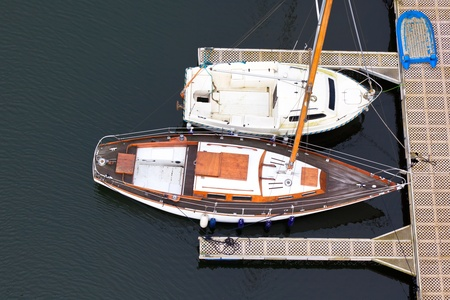 Wooden sailing-boats near pier from above photo
