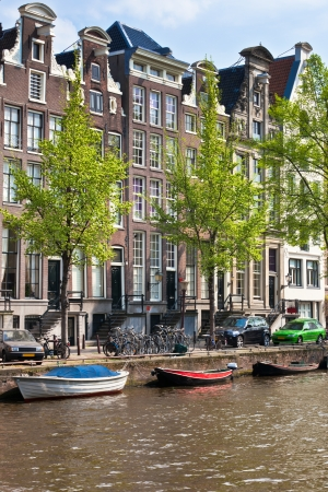 dutch canal house: Amsterdam canals sunny view. vertical shot
