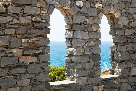 Sea view through old stone castle windows. Portovenere, Italy