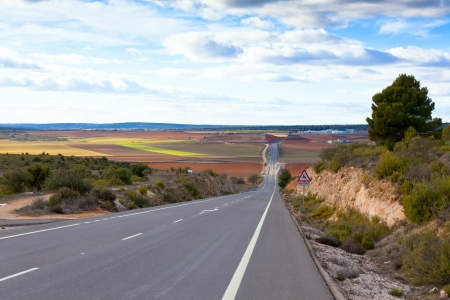 Empty rural road in fields of Central Spain. Horizontal shot Stock Photo