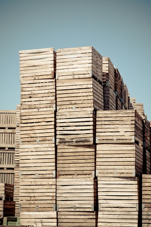 Grunge Crates stack. weathered wooden boxes in tall rows. Vignetted shot photo