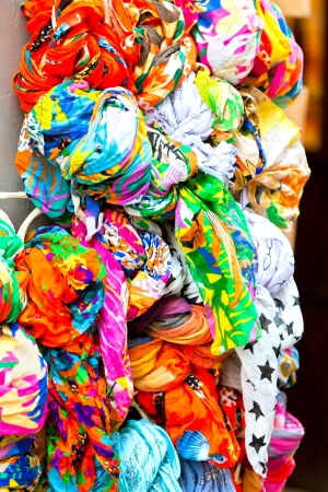 Many bright color cotton scarves on sale. Vertical shot photo