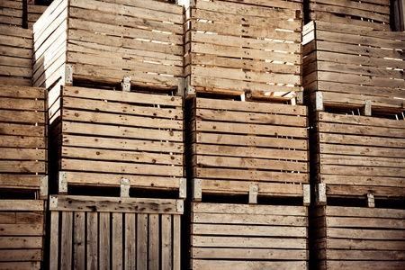 Grunge Crates stack. weathered wooden boxes in rows. toned and vignetted image photo