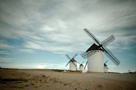vignetted: Old Spanish windmills, Campo de Criptana, Castilla la Mancha province, Spain. Toned and vignetted image Stock Photo