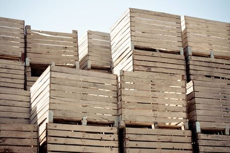 Grunge Crates stack. weathered wooden boxes in tall rows. horizontal toned and vignetted image