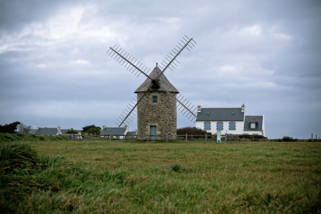 Dull Landscape with Old windmill in Brittany, Western France. Toned image Stock Photo