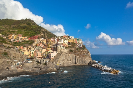 View of Manarola, small Italian village of Cinque Terre on the mediterranean sea photo