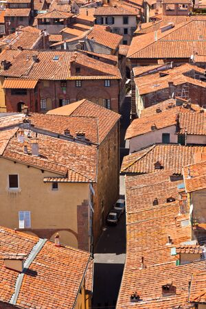 View over Italian town Lucca with typical terracotta roofs photo