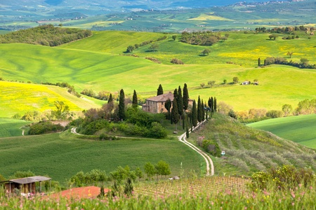 Outdoor Tuscan Farmhouse and hills landscape. Horizontal shot