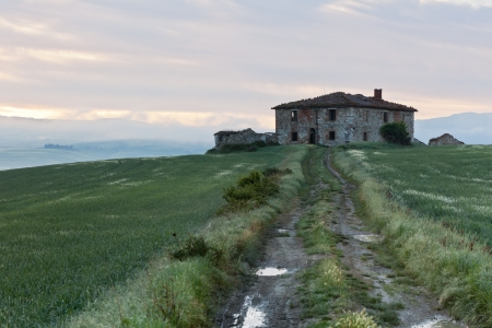 Morning fog view on Abandoned farmhouse at Valley d?Orcia in Tuscany, Italy. photo
