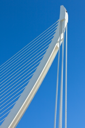 Modern bridge geometry: white against bright blue Stock Photo - 14690358