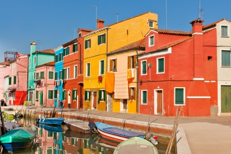 Colorful houses along canal in the island of Burano near Venice, Italy Stock Photo